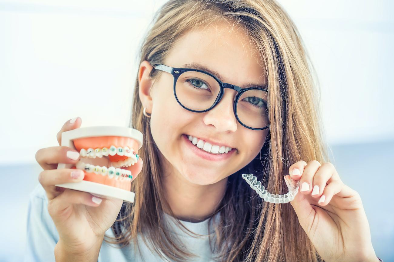 Comparing Metal Braces and Invisalign Offered by Our Cosmetic Dentist in Houston