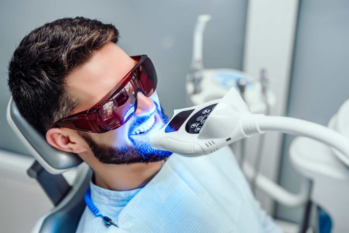 Houston cosmetic dentist patient undergoing an in-office teeth whitening treatment