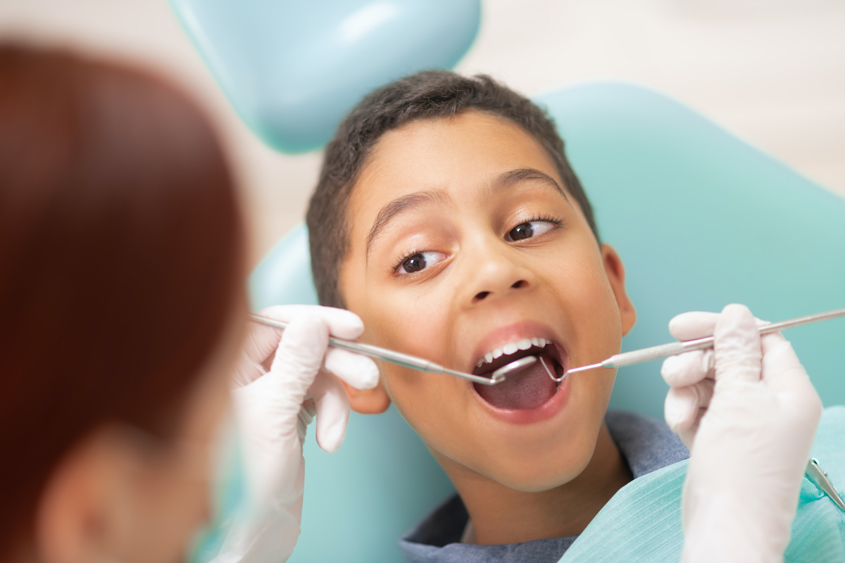 young boy getting a dental check up at our Houston dentist office